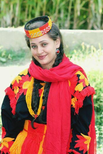 KALASH Tribe of CHITRAL PAKISTAN. A beautifull Kalash Girl in her Traditional Dress. Photo captured by MUHSIN UL MULK Beautiful Woman Happiness Looking At Camera