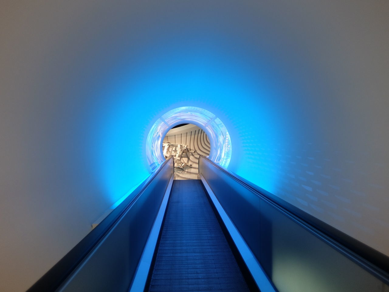 Low Angle View Of Illuminated Escalator