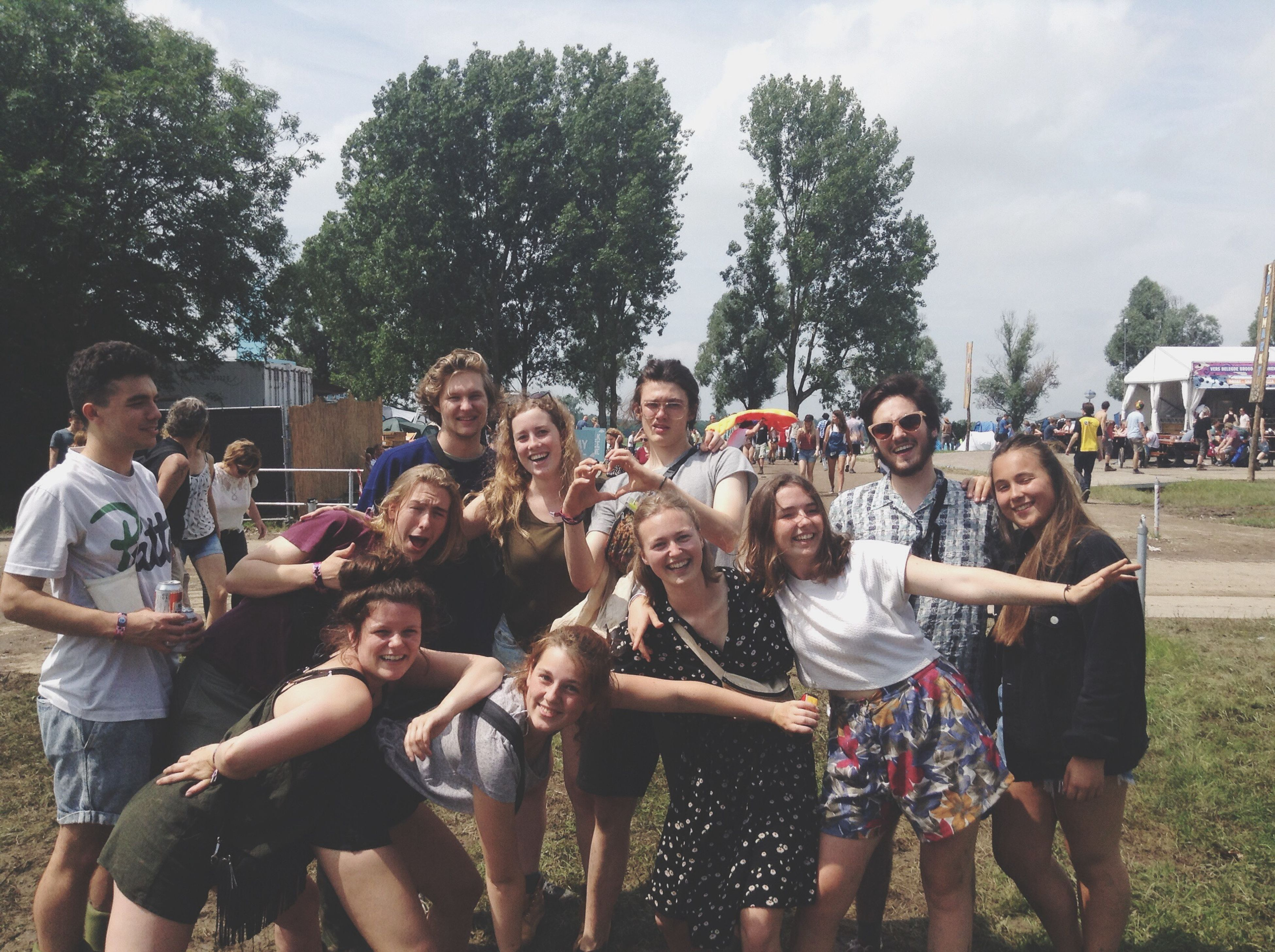 lifestyles, togetherness, leisure activity, casual clothing, bonding, person, friendship, happiness, young adult, love, smiling, enjoyment, tree, young women, large group of people, fun, sitting