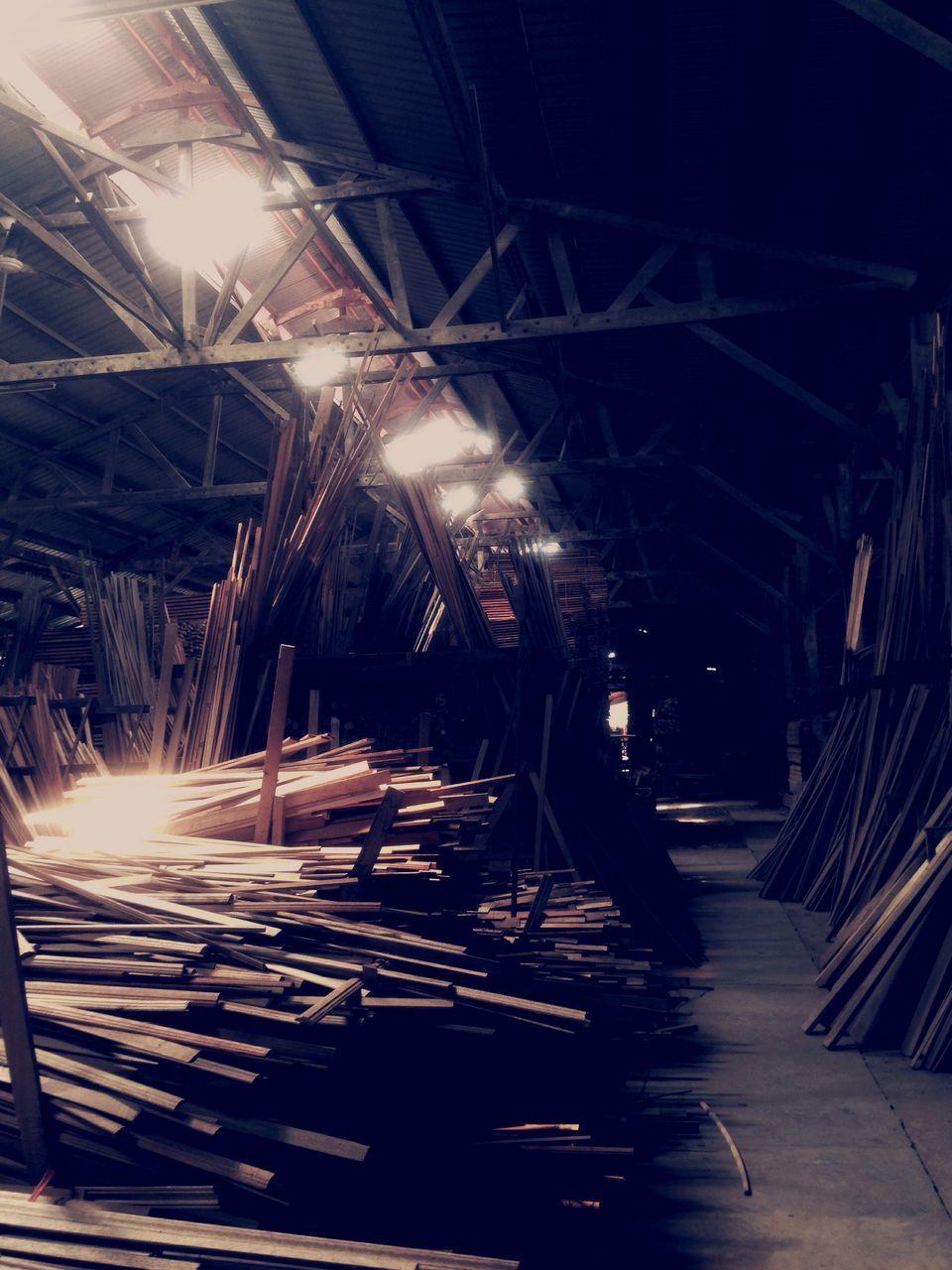 illuminated, indoors, night, lighting equipment, workshop, light beam, no people, metal industry, warehouse, industry, factory, occupation, technology