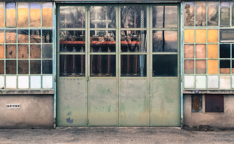 Closed -- Building Exterior Built Structure Closed Workshop Door Metal Metal Door Mirrored Reflection Reflection The City Light Window Panes Windows Workshop