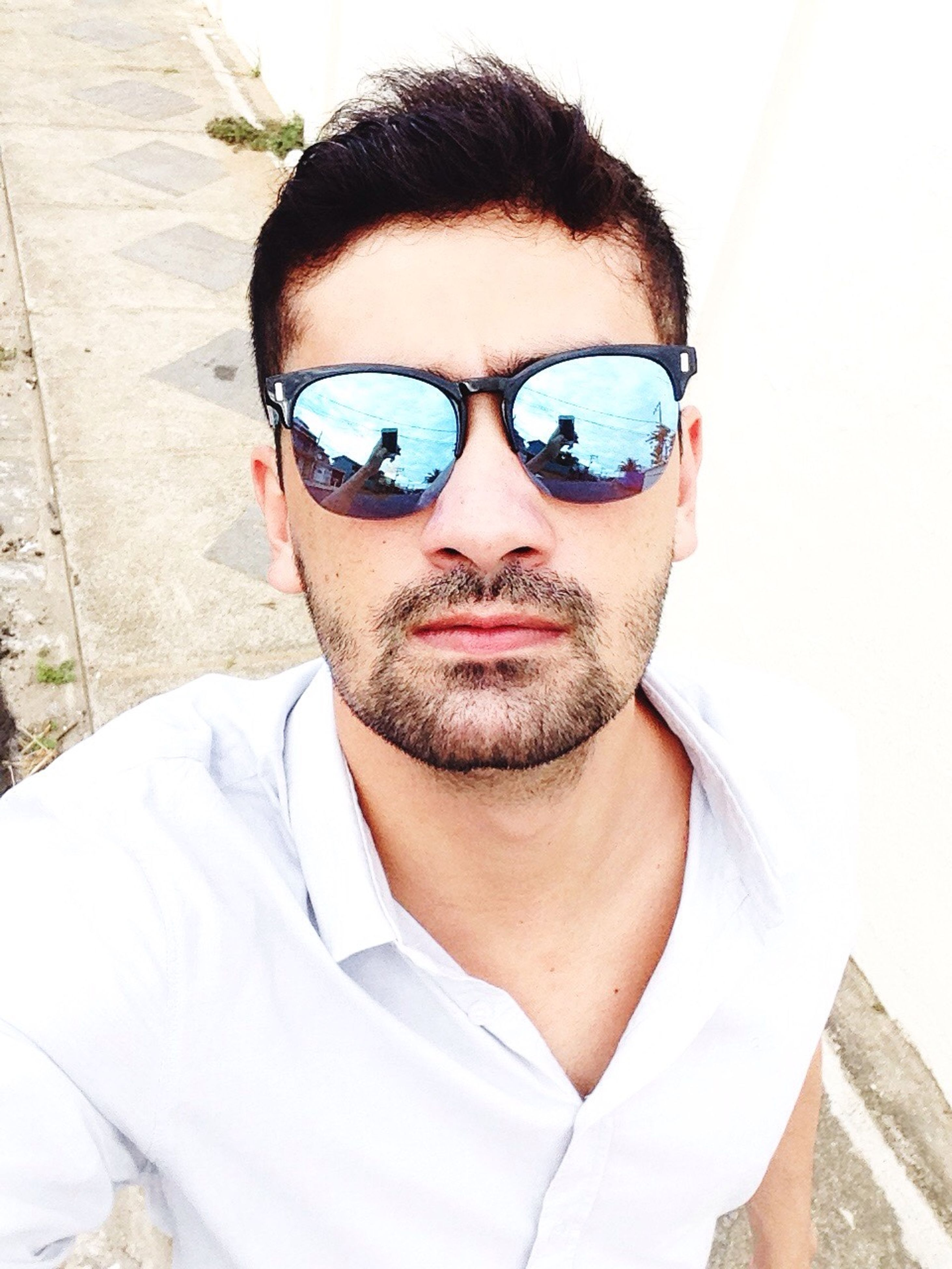 looking at camera, portrait, real people, front view, lifestyles, sunglasses, one person, young adult, confidence, one young man only, attitude, standing, headshot, leisure activity, day, outdoors, one man only, only men, adults only, people, adult