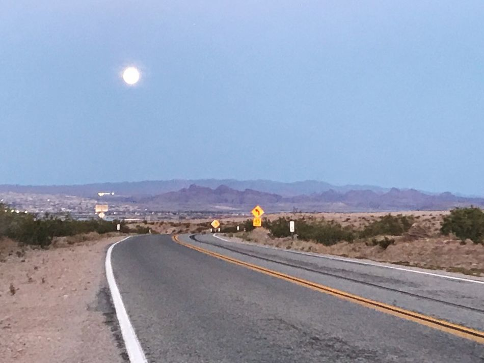 Road Blue Sky Clear Sky Transportation Nature Outdoors Moon The Way Forward No People Scenics Landscape Tranquil Scene Beauty In Nature Day Moon Rising Non-urban Scene Desert Beauty Backroad Photography Iphonephotography