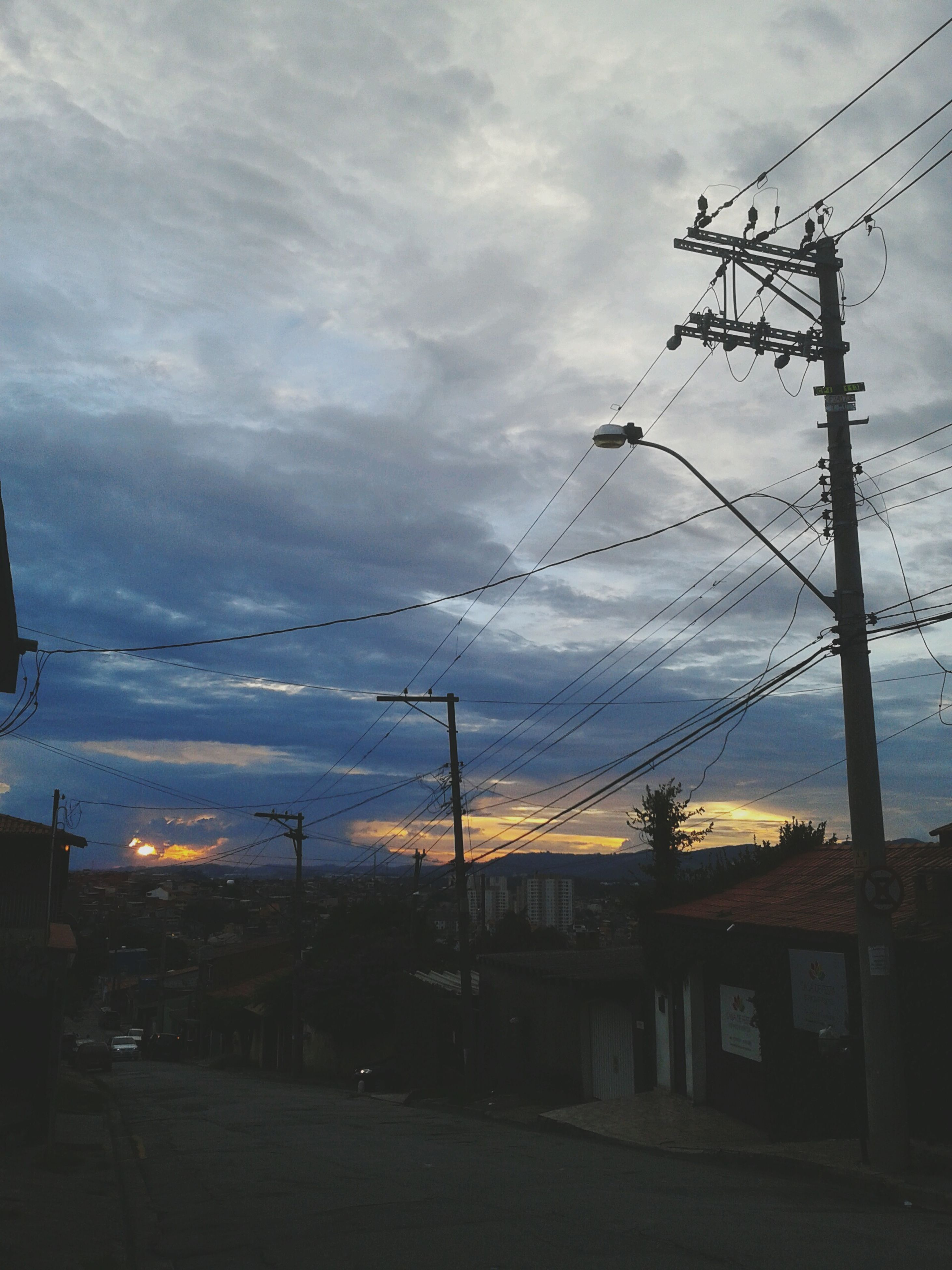 power line, electricity pylon, sky, cable, power supply, electricity, connection, cloud - sky, built structure, architecture, fuel and power generation, building exterior, cloudy, sunset, power cable, cloud, low angle view, transportation, silhouette, technology