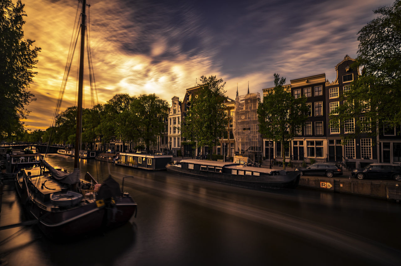 Amsterdam Architecture Beer Blue Boat Canal City Dutch Europe Holiday Horizon Over Water Long Exposure Mode Of Transport Move Nautical Vessel No People Orange Outdoors Reflection Remo SCarfo Sky Sunshine Touristic Touristic Destination Water