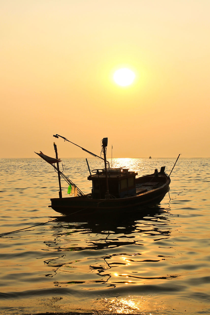 sunset, orange color, water, silhouette, sea, sun, nautical vessel, transportation, nature, mode of transport, men, beauty in nature, scenics, sky, waterfront, outdoors, tranquility, real people, horizon over water, occupation, fisherman, longtail boat, sailing, people