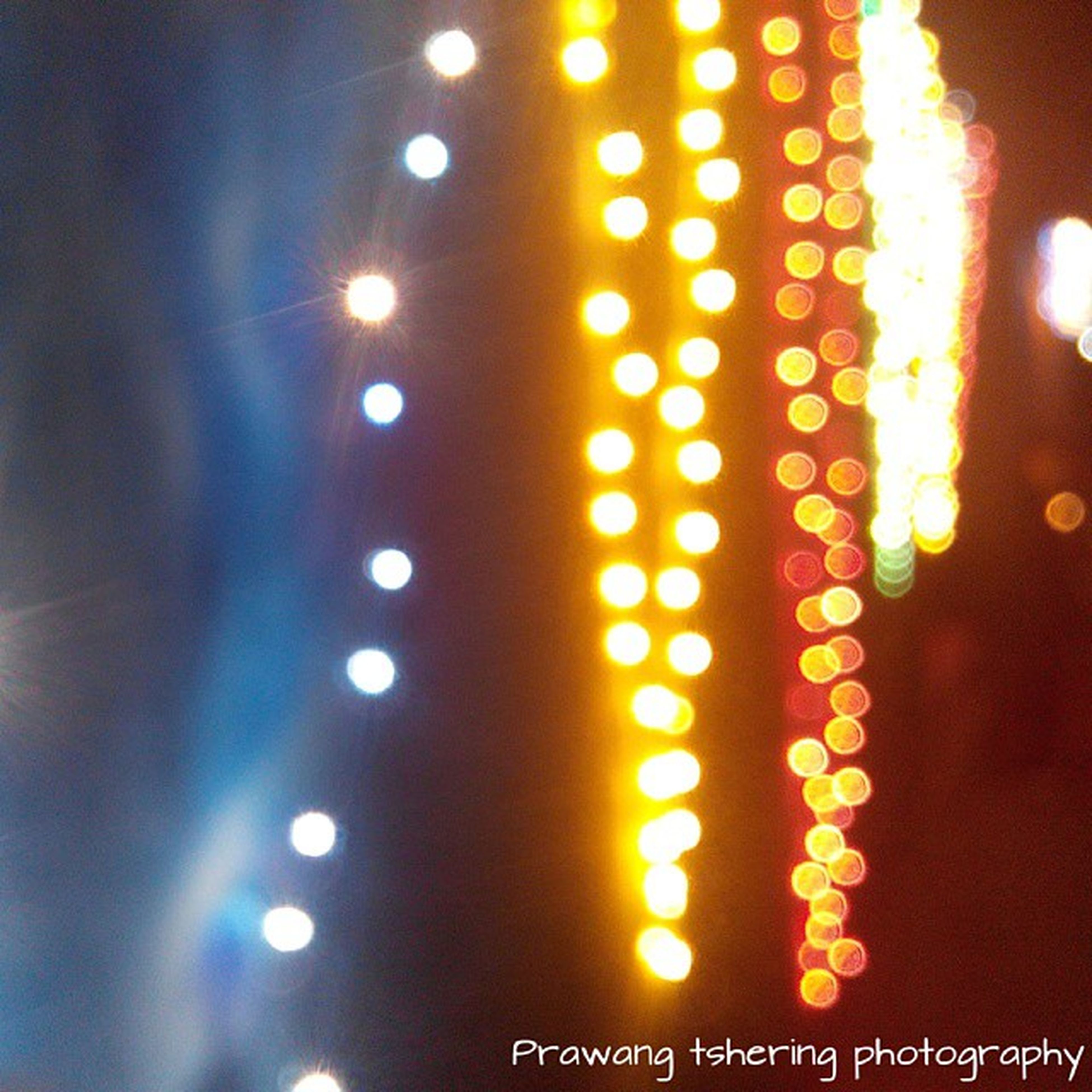 illuminated, indoors, night, lighting equipment, glowing, text, light - natural phenomenon, close-up, communication, pattern, western script, decoration, no people, lit, defocused, hanging, electricity, circle, number, electric light