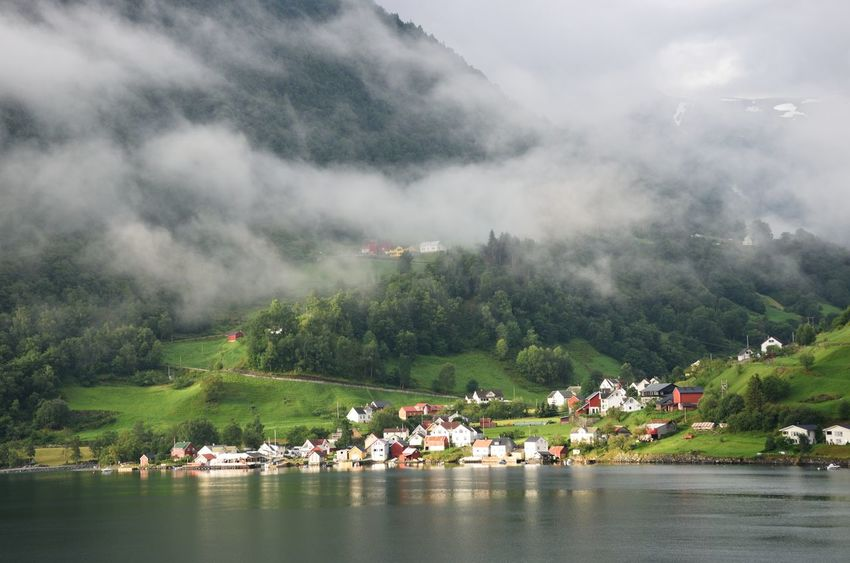 Norway Beauty In Nature Clouds Cruise Fjord Mountain Mountains Nature Outdoors Scandanavia Scenics Sky Tranquility Village Water