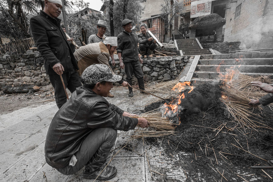 China Yunnan ,China Ziseetheworld Ziwang Villagers Village Village Life Pig Local Food Culture villagers smoke a pig then kill it to sacré to their ancestors on tomb sweeping festival. Tomb Sweeping Festival