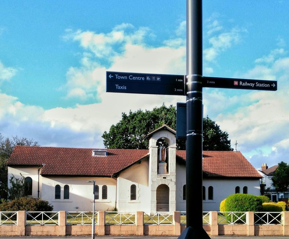 Signs Sign Post Sky And Clouds Summer Directions In The City City Which Direction? Churches
