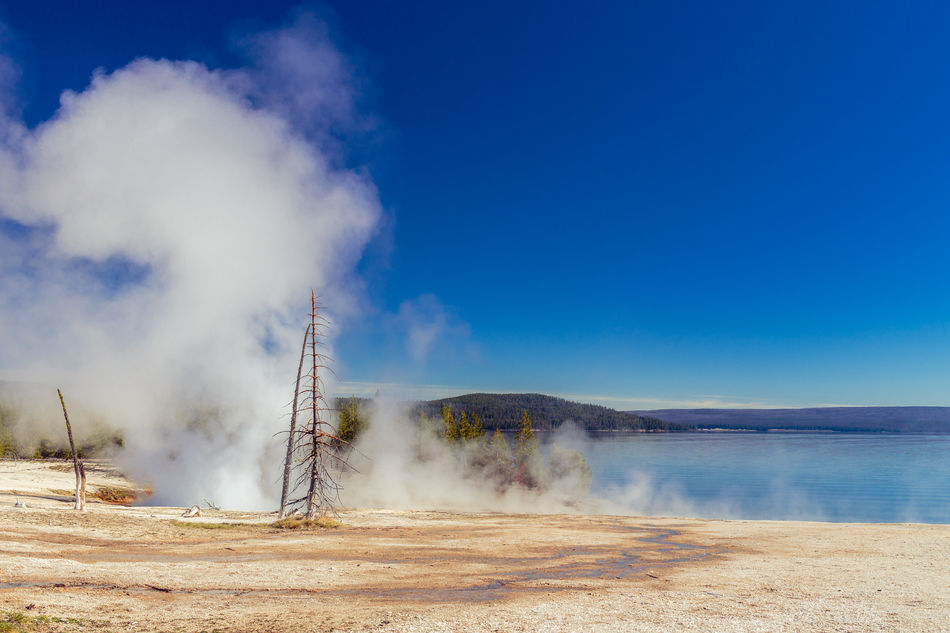 Blue Copy Space Geothermal Activity June Landscape Morning No People Non-urban Scene Outdoors Scenics Steam Travel Destinations Water West Thumb West Thumb Geyser Basin Wyoming Yellowstone Lake Yellowstone National Park