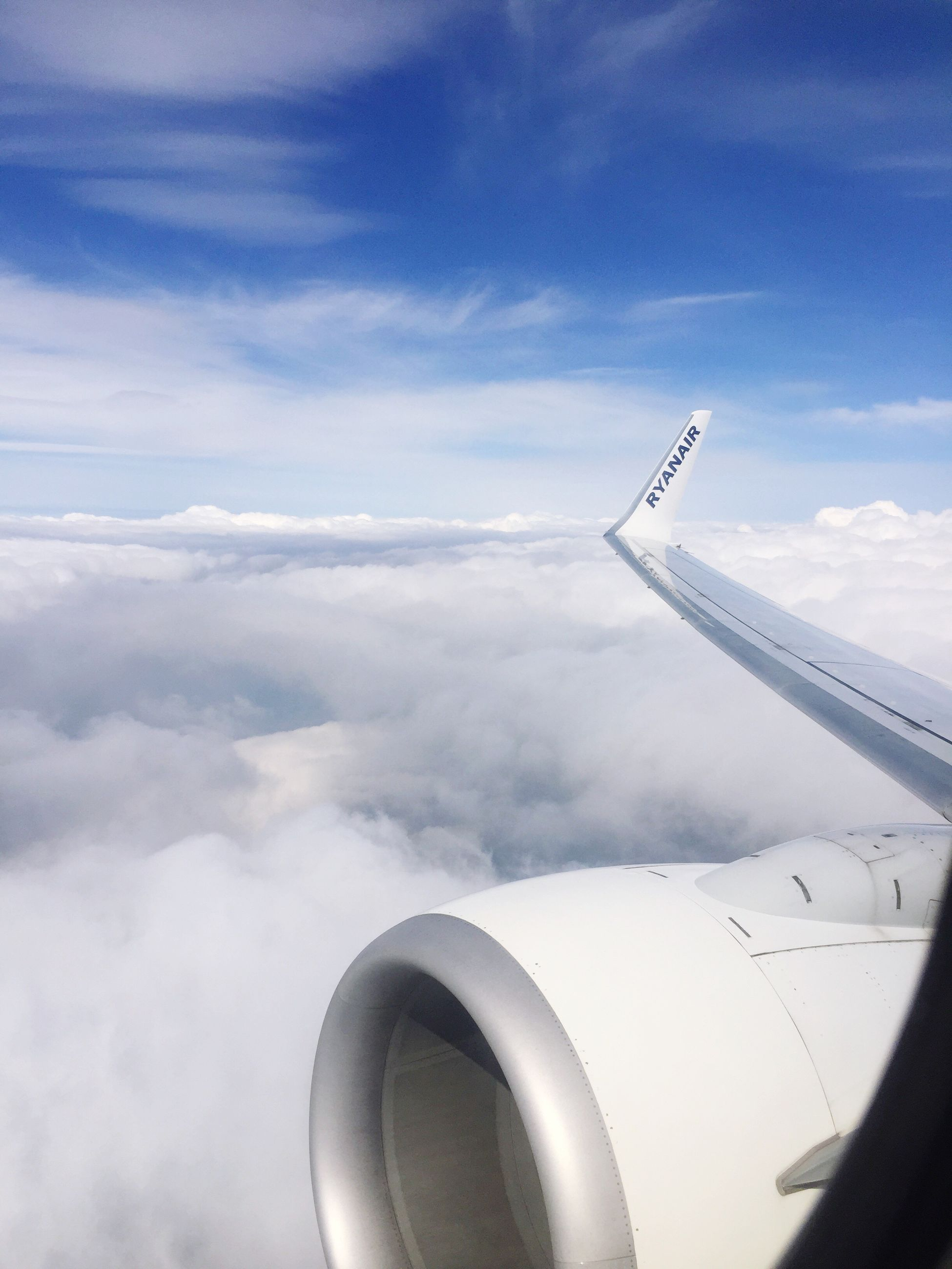 airplane, transportation, flying, aerial view, aircraft wing, travel, cloud - sky, air vehicle, sky, mode of transport, day, no people, public transportation, nature, outdoors, airplane wing