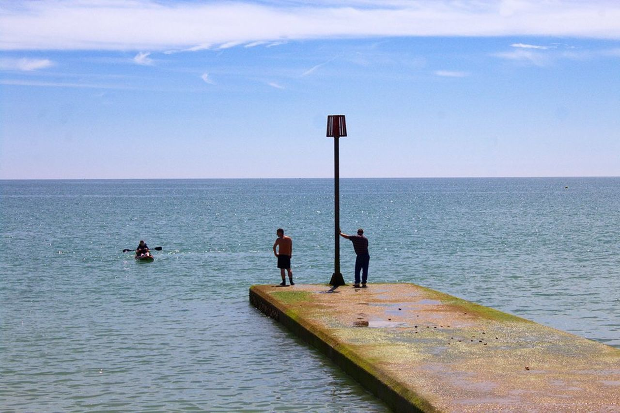 Waiting for their friend to come to them after rowing out... Adult Beauty In Nature Day Friendship Full Length Horizon Over Water Leisure Activity Lifestyles Men Nature Outdoors People Real People Scenics Sea Sky Standing The Great Outdoors - 2017 EyeEm Awards Togetherness Water