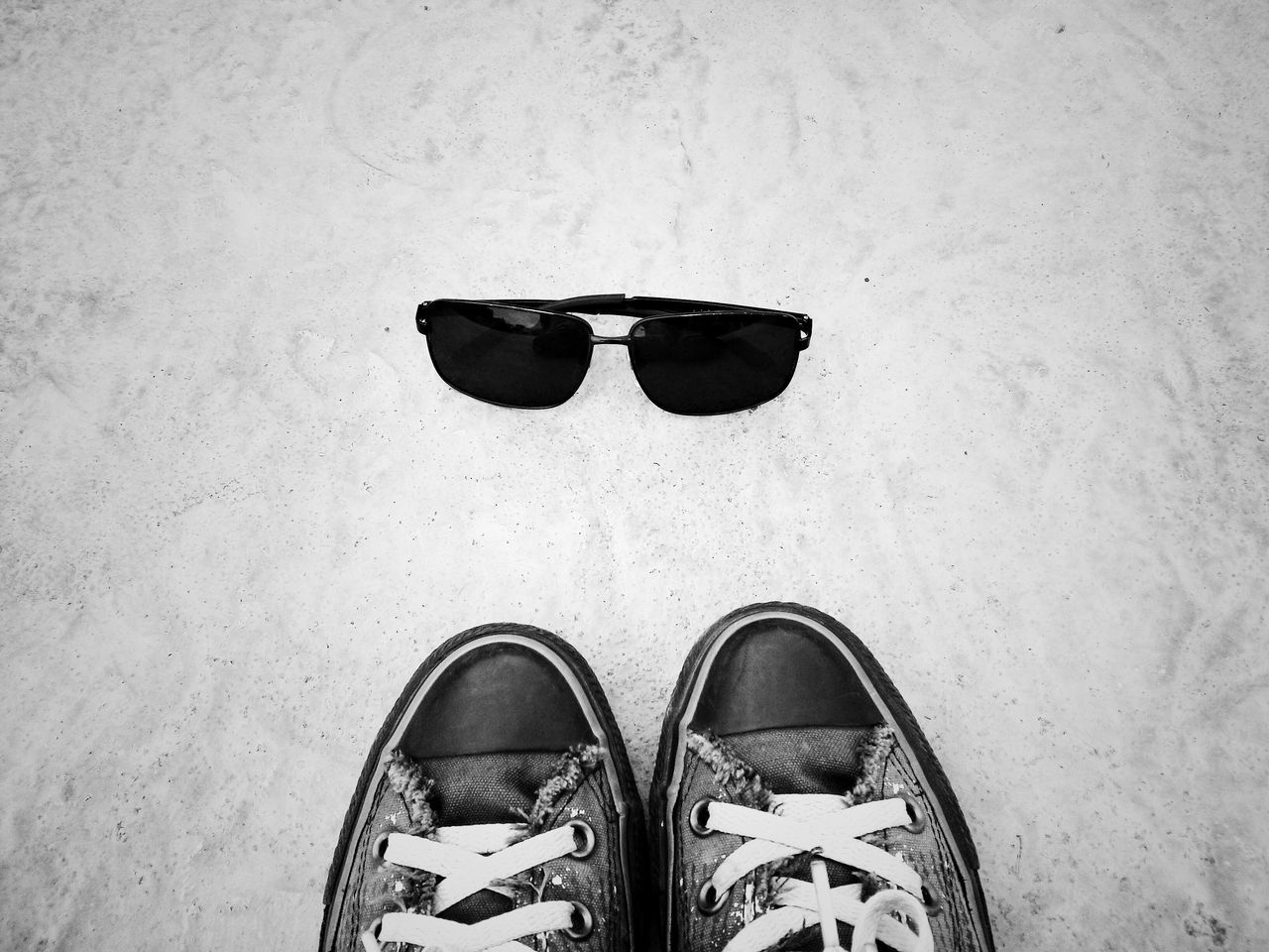 shoe, personal perspective, human leg, pair, one person, low section, standing, directly above, human body part, high angle view, canvas shoe, real people, sunglasses, fashion, lifestyles, day, indoors, men, close-up, adult, people