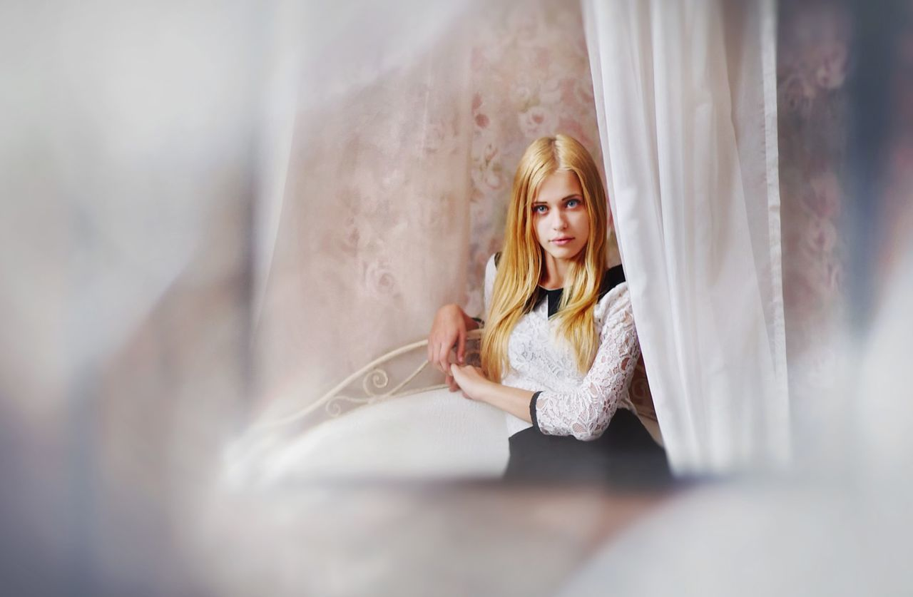 young adult, one person, young women, indoors, casual clothing, selective focus, curtain, real people, blond hair, home interior, beautiful woman, leisure activity, women, day, portrait, people