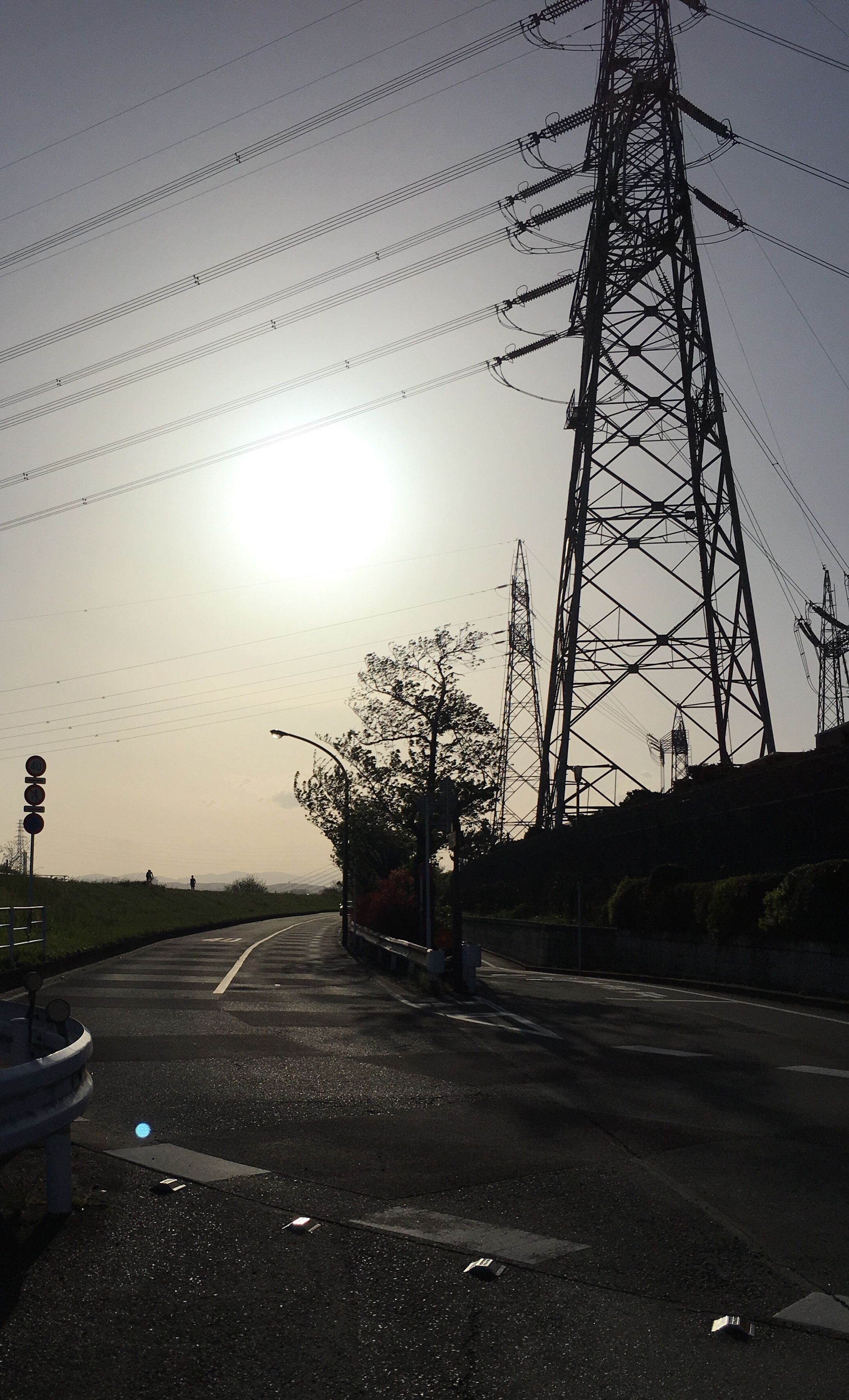 road, transportation, the way forward, electricity pylon, power line, street, clear sky, tree, bare tree, sky, silhouette, sunset, sun, sunlight, road marking, diminishing perspective, connection, street light, vanishing point, outdoors
