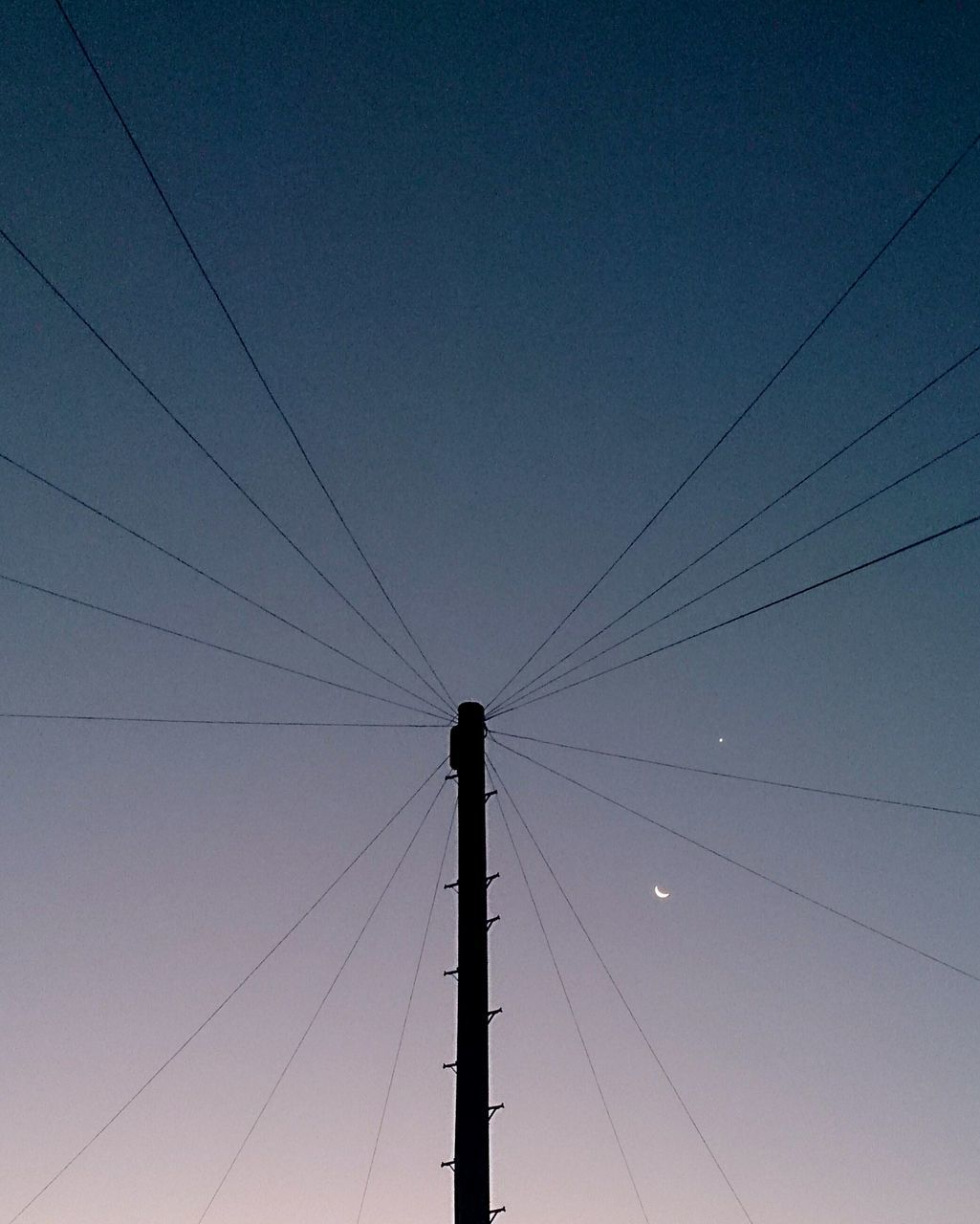 Low Angle View Of Silhouette Telephone Pole Against Sky At Dusk
