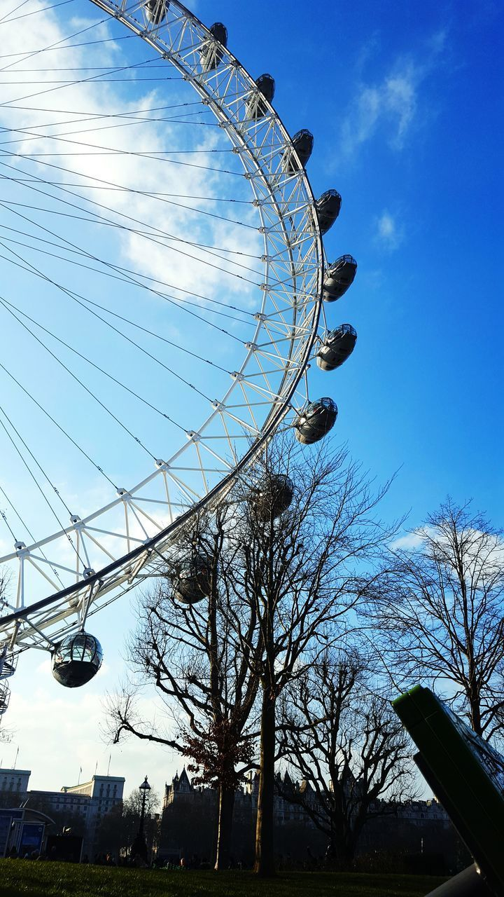 low angle view, amusement park, ferris wheel, arts culture and entertainment, big wheel, no people, sky, amusement park ride, day, outdoors, built structure, architecture