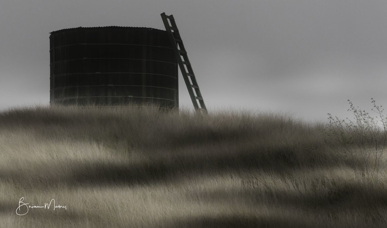 Ranch Water Tank Agriculture Architecture Built Structure Clouds And Sky Day Grassland Hawaii Ladder Nature No People Outdoors Pasture Sky Sky And Clouds Watertank
