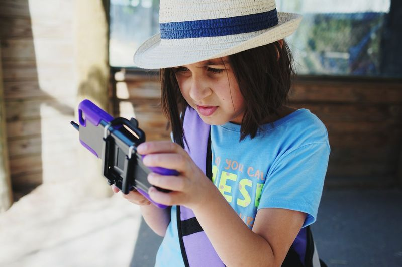 checking the photos. Technology Headshot Discovery Outdoors Childhood Real People Close-up Photography Themes Lifestyles One Person Learning Photography Selfy Stick Mobilephotography Phone Photography Phone Smartphone Photography Looking