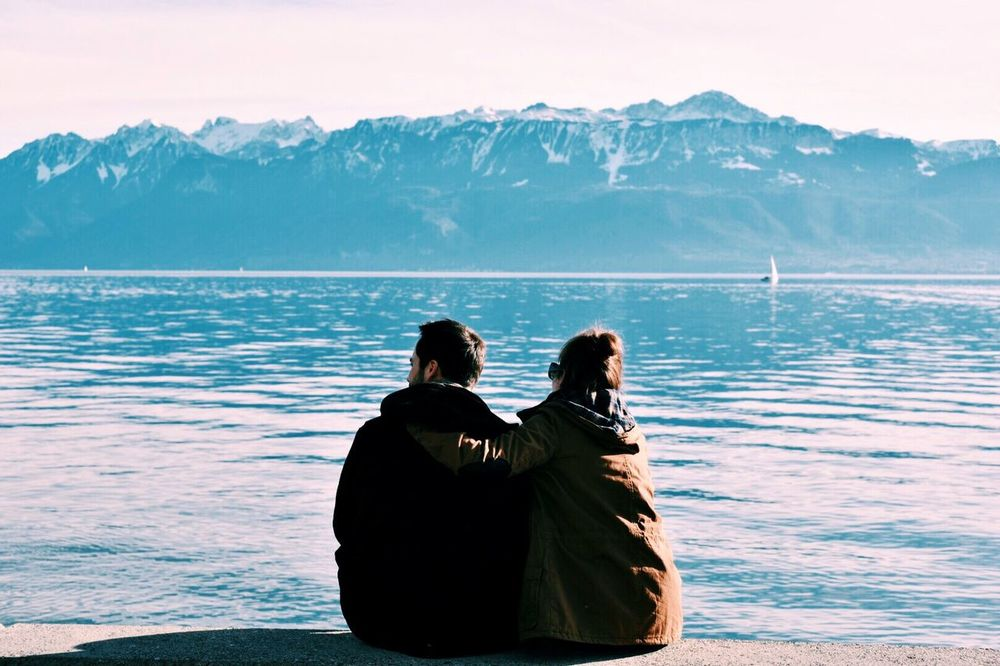 Two People Mountain Rear View Togetherness Mountain Range Leisure Activity Relationship Adults Only Beauty In Nature Day Lake Scenics Outdoors People Bonding Real People Nature Snow Adult Water Lake View Couple Cute Love Goals