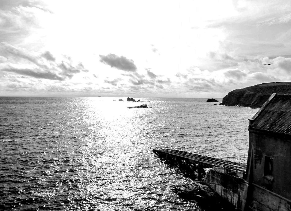 Slide slowly into the light and beyond Sky Sparkling Water Lifeboat Station... Sea And Sky Monochrome Black And White Rocks And Water Cornwall Beauty In Everything For My Friends That Connect AMPt_community No People Cornwall Uk Seascape Beauty In Nature Summertime EyeEm Nature Lover Ocean Water Nature Sea View Ladyphotographerofthemonth Architecture Eyeem Photo