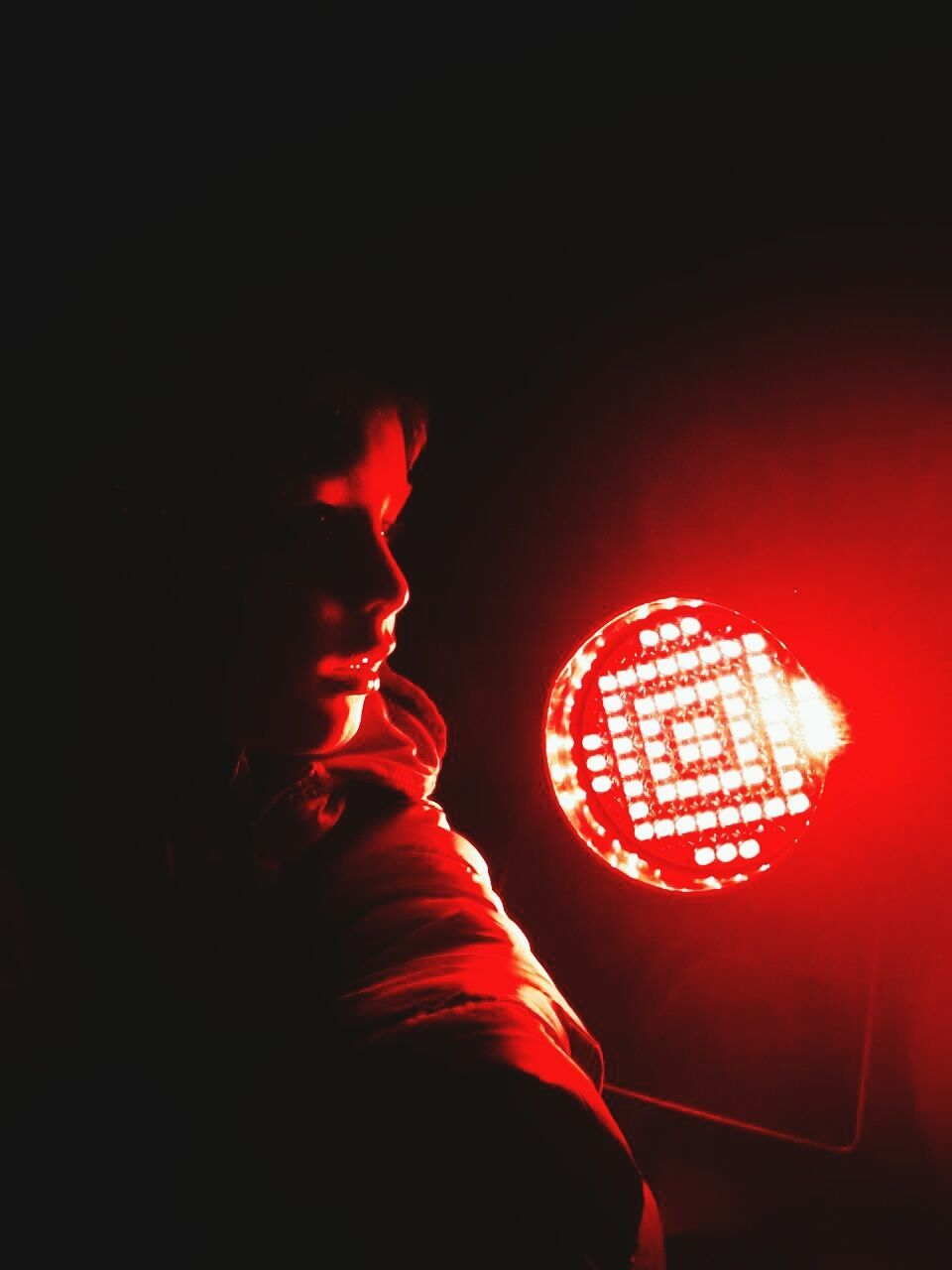 illuminated, red, one person, real people, night, indoors, technology, close-up, only men, people
