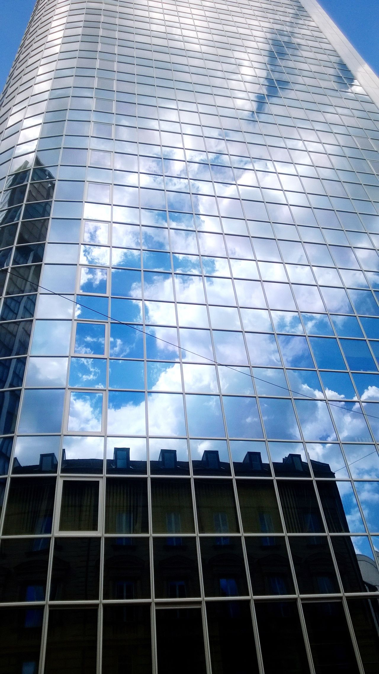 Architecture Glass - Material Building Exterior Modern Reflection Built Structure Window City Low Angle View Sky Blue Skyscraper No People Futuristic Outdoors Building Reflections Office Building Exterior Office Block Sunlight Cloud - Sky