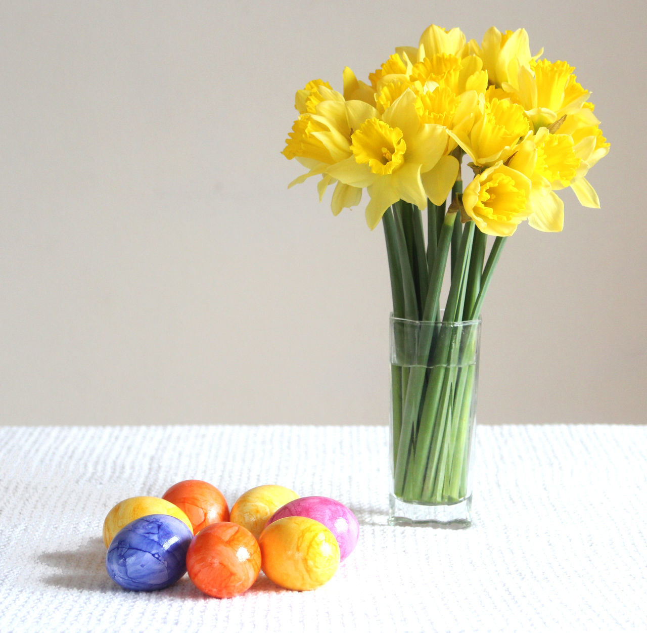 Happy Easter! daffodils and colored eggs Flower Yellow Freshness Fragility Vase Nature Flower Head Indoors  Arrangement Close-up Beauty In Nature No People Flower Arrangement Day Daffodils Spring Flowers Springtime Colored Eggs Easter Eggs Easter Decoration Colorful Celebration Table Copy Space