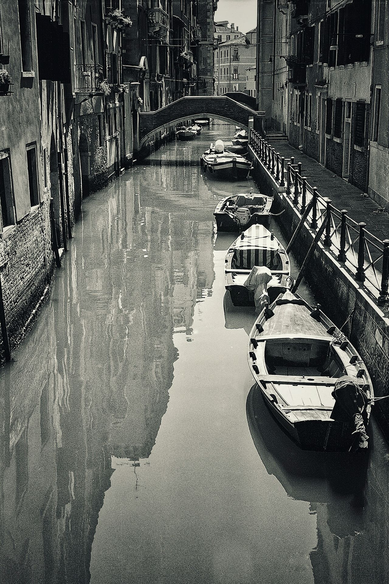 The back streets of Venice. Travel Photography Blackandwhite Black And White Film Black & White Film Is Not Dead Black And White Photography Blackandwhite Photography Italy Holidays Italy Venice Venice Italy Canals Venice Italy Leading Lines Leadinglines Transportation