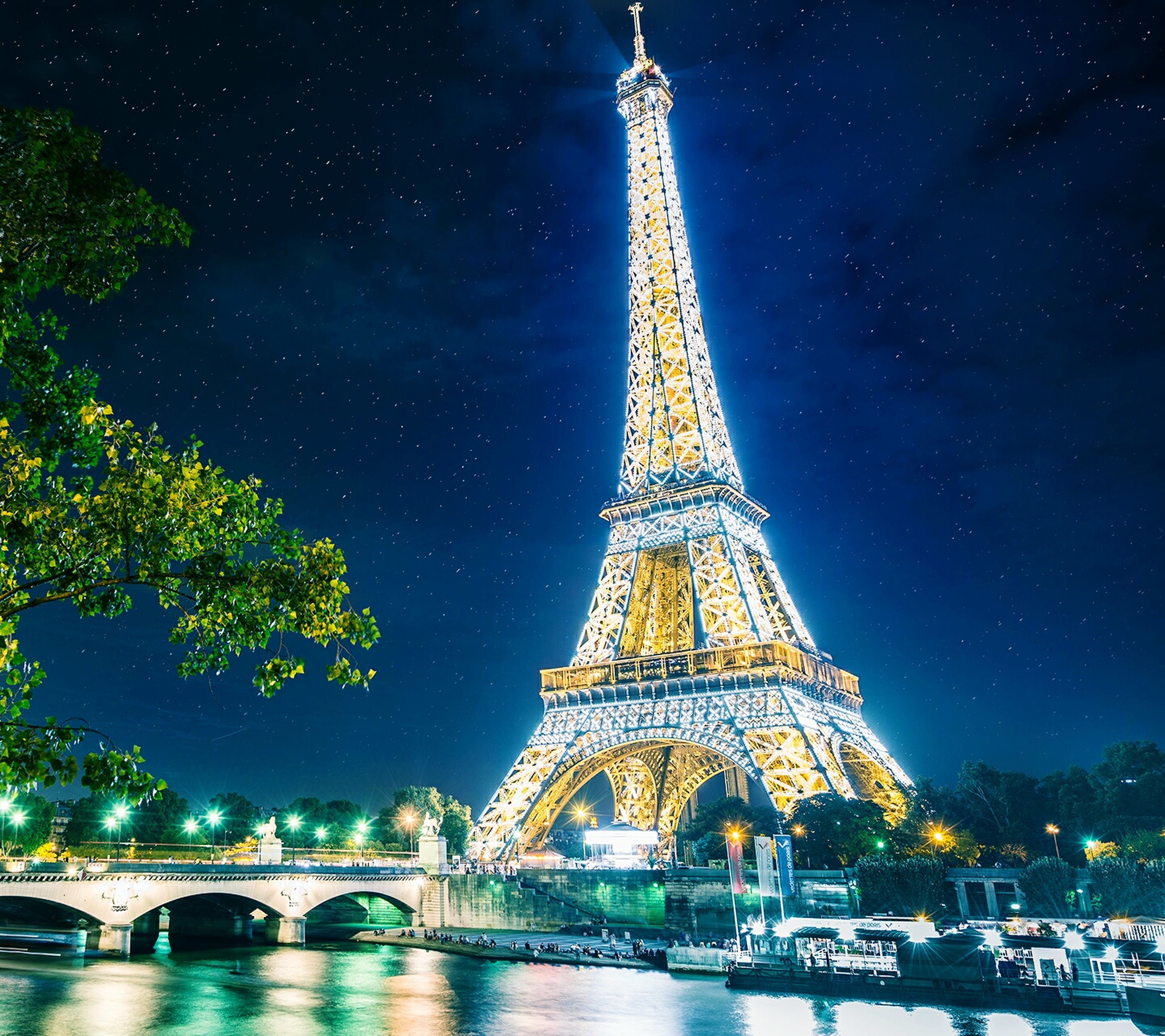 night, travel destinations, famous place, travel, tourism, international landmark, built structure, architecture, illuminated, eiffel tower, capital cities, sky, water, tree, culture, tower, low angle view, history, river, building exterior
