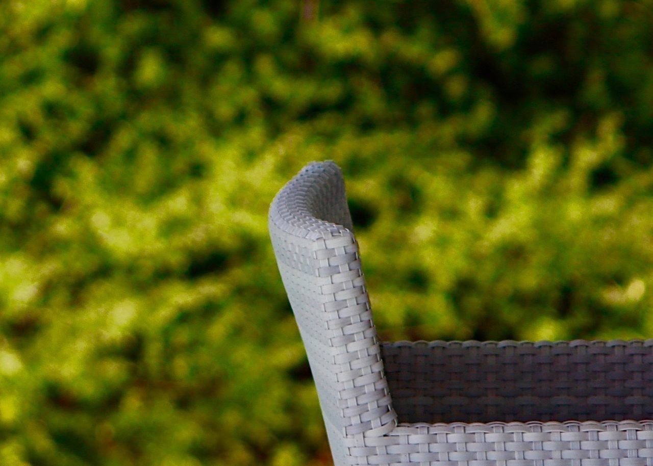 Outdoor chair in front of green flora Focus On Foreground Close-up Nature Outdoors Green Color Greenery Flora Plants Take Your Place Exterior Garden Photography Relax Abstract Summer Backgrounds Fine Art Simplicity Minimalism Colorful