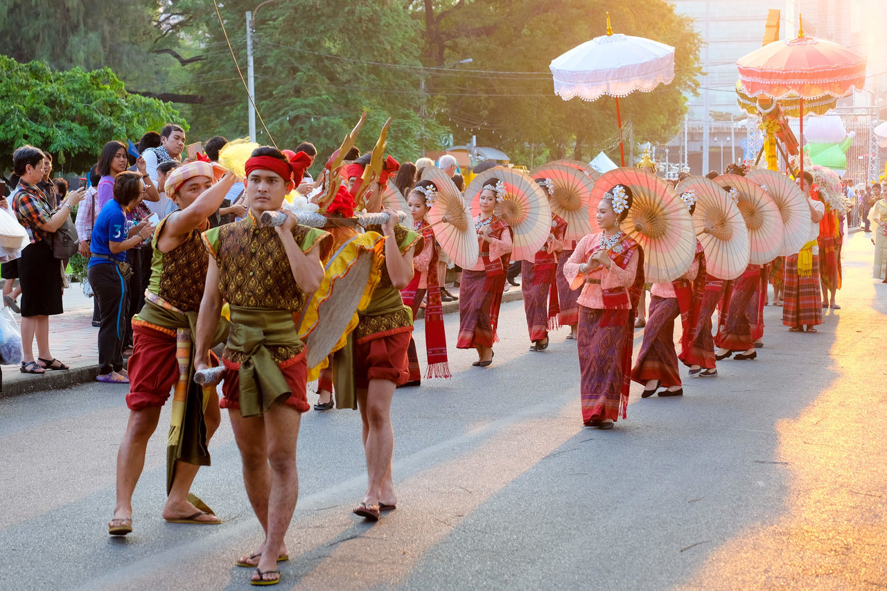 large group of people, real people, men, celebration, traditional clothing, cultures, tradition, parade, togetherness, women, day, outdoors, full length, traditional dancing, lifestyles, performance, military uniform, adult, people, adults only