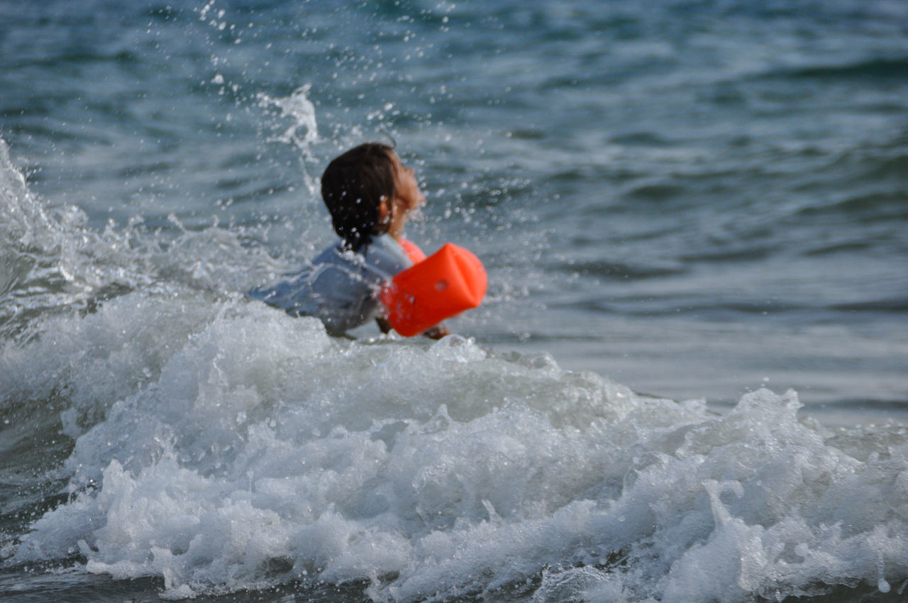 Playing with waves Enjoying Life Adventure Armbands Day Enjoyment Floating Current Meter Full Length Fun Fun Learn To Swim Leisure Activity Lifestyles Motion Nature Outdoors Playing With Waves Redspot Rippled Swimmies Vacations Water Water Wings Wave Waves