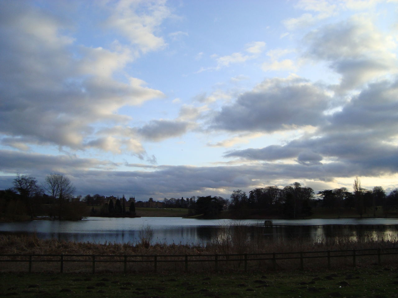 Evening View of Blenham Palace across the pond Atmospheric Mood Blenheim Blenheimpalace Cloud Cloud - Sky Cloudscape Cloudy Distant Dramatic Sky Lake Majestic Manor Manor House Moody Sky Orange Color Outdoors Pond Remote Scenics Silhouette Sky Storm Cloud Sunset Tranquil Scene Tranquility