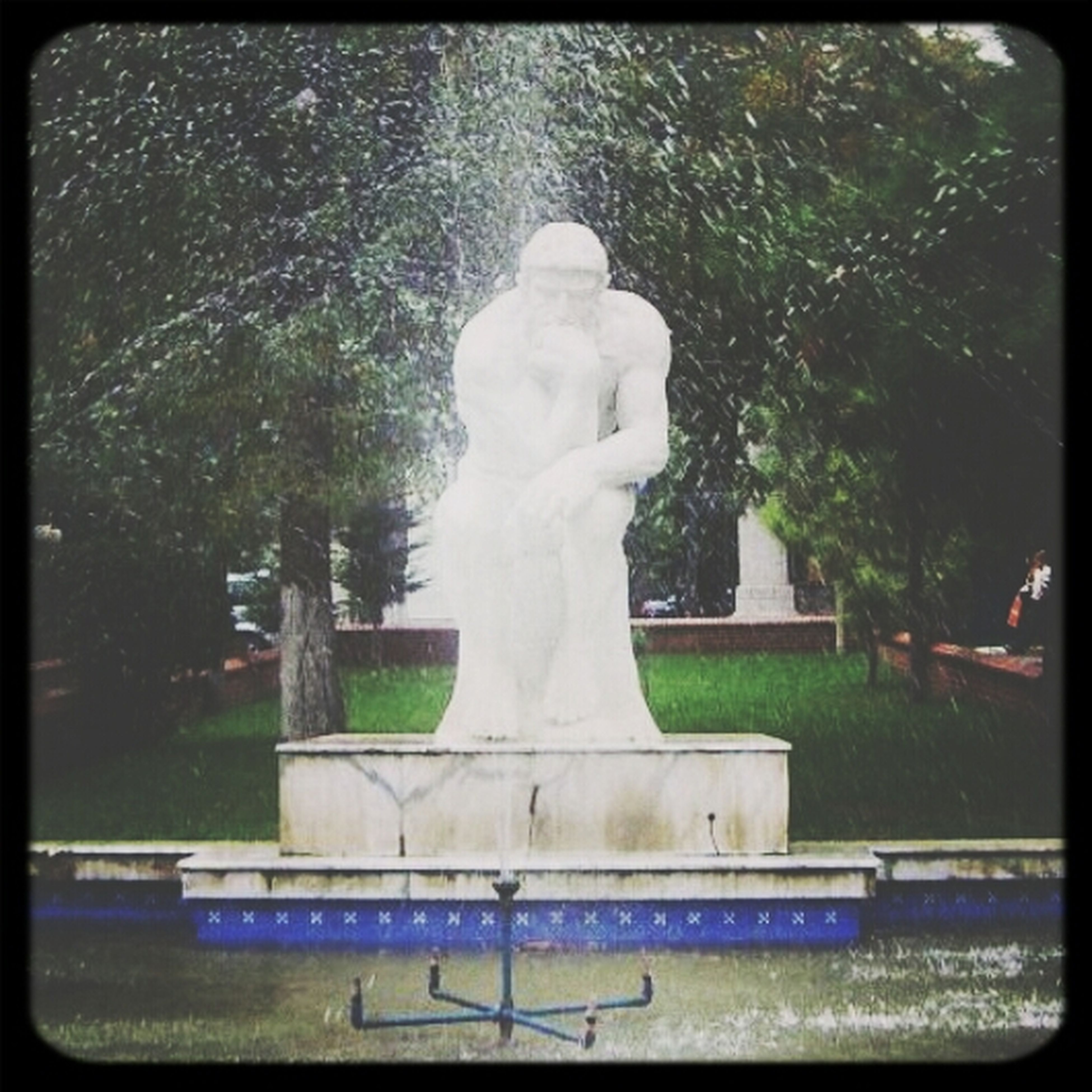 statue, human representation, sculpture, art and craft, art, creativity, transfer print, tree, animal representation, auto post production filter, park - man made space, fountain, carving - craft product, memorial, day, built structure, outdoors, craft