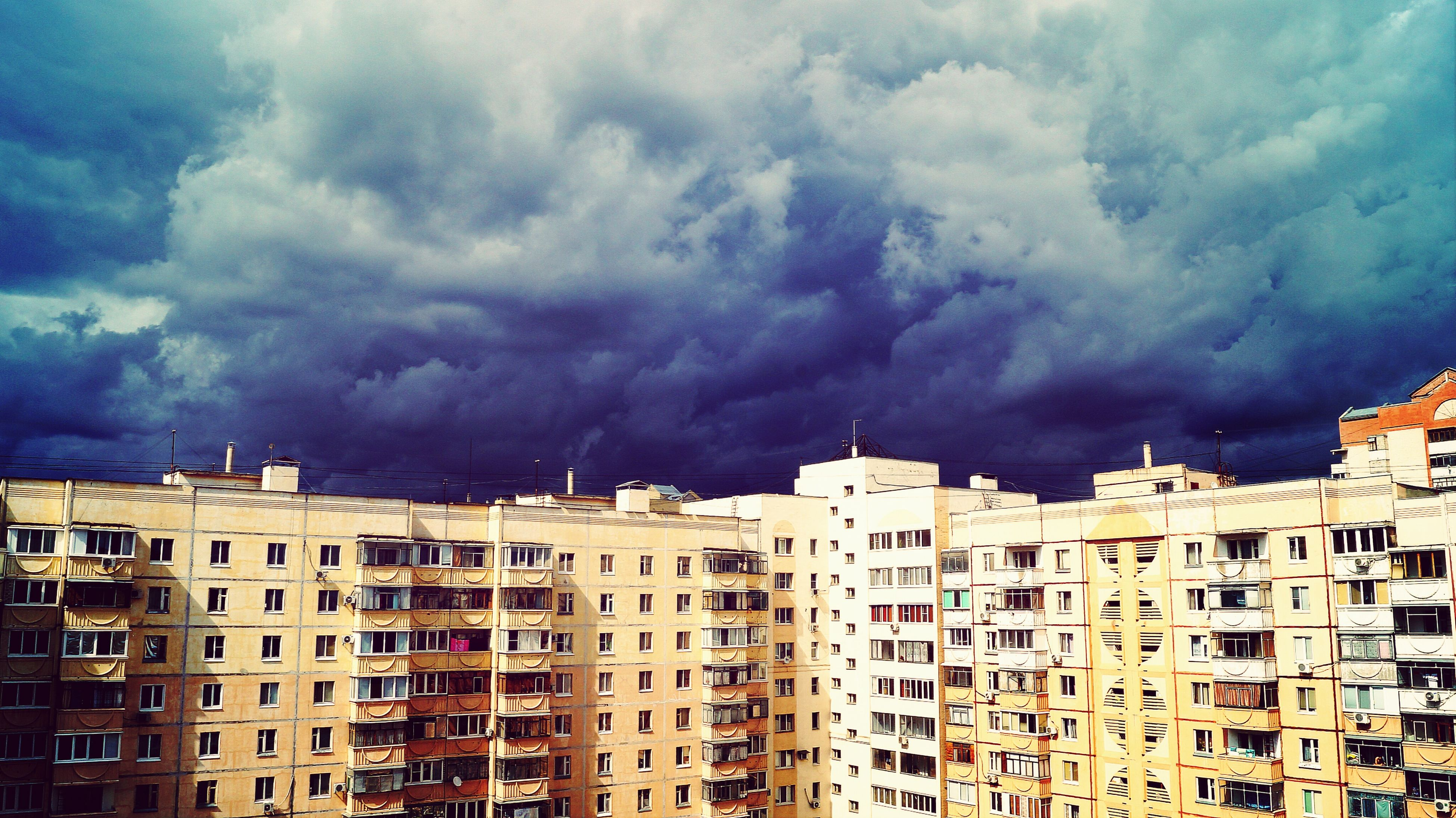 architecture, building exterior, built structure, sky, cloud - sky, cloudy, city, residential structure, residential building, weather, residential district, overcast, cloud, storm cloud, building, low angle view, cityscape, house, outdoors, no people