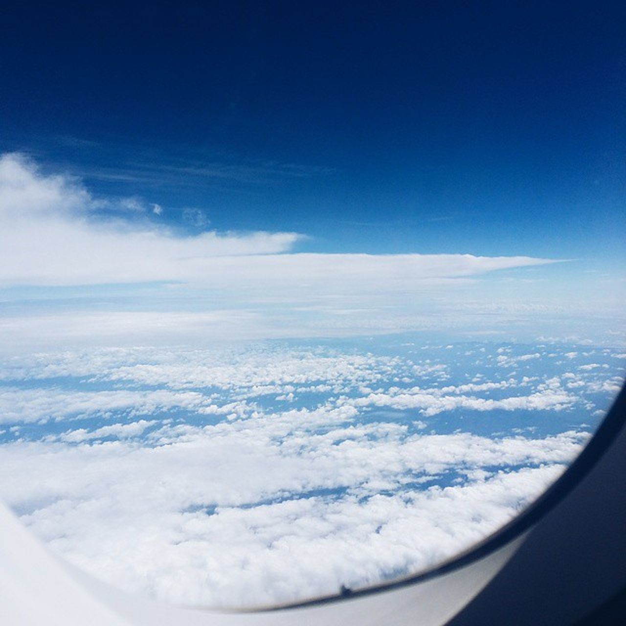 aerial view, airplane, beauty in nature, nature, cloud - sky, journey, scenics, cloudscape, sky, airplane wing, tranquility, travel, tranquil scene, transportation, no people, blue, the natural world, flying, day, outdoors, vehicle part, sky only, landscape, air vehicle, backgrounds, water