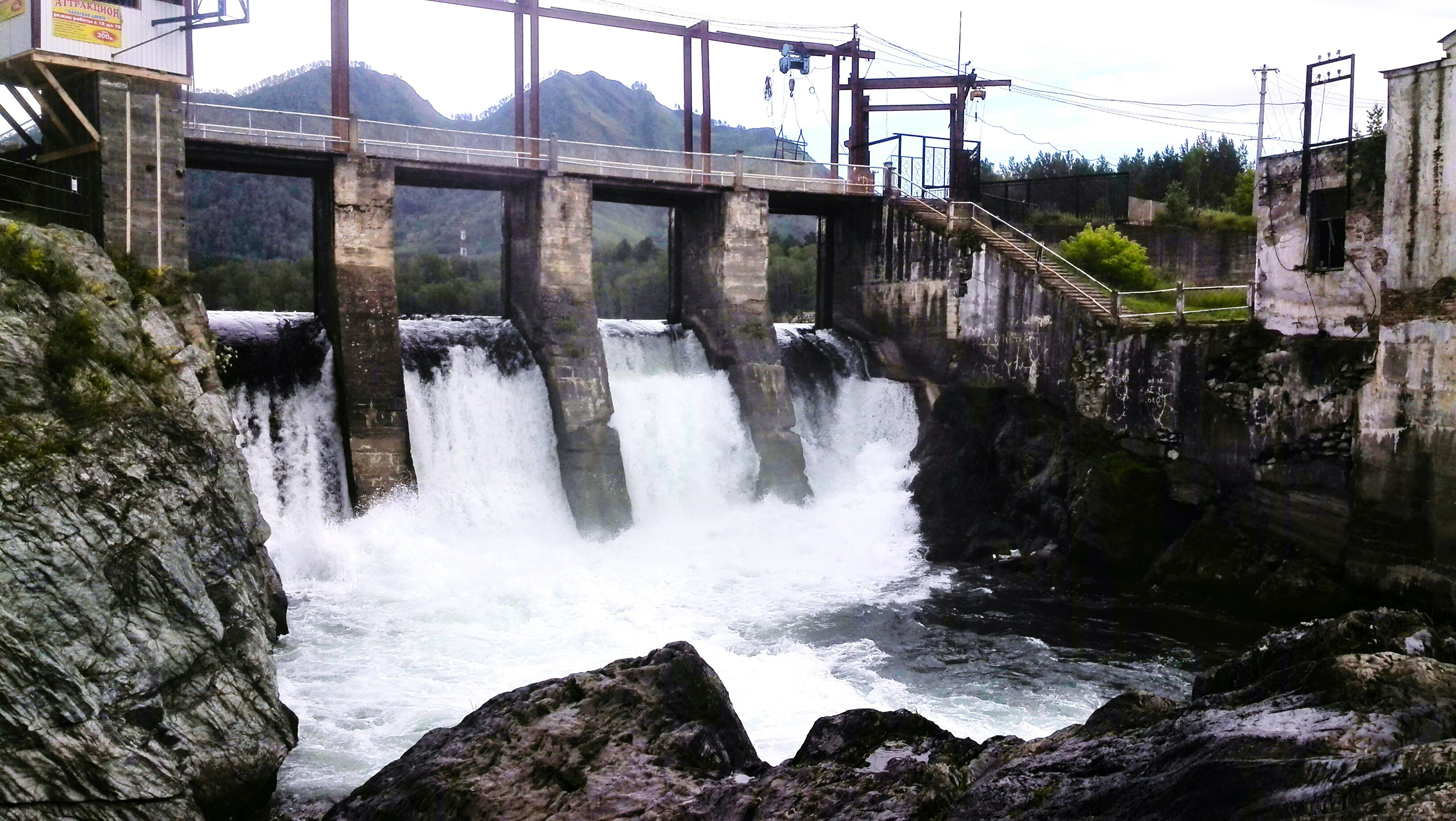water, motion, flowing water, connection, waterfall, built structure, bridge - man made structure, flowing, architecture, river, rock - object, nature, power in nature, sky, day, outdoors, dam, no people, beauty in nature, scenics, travel destinations, idyllic