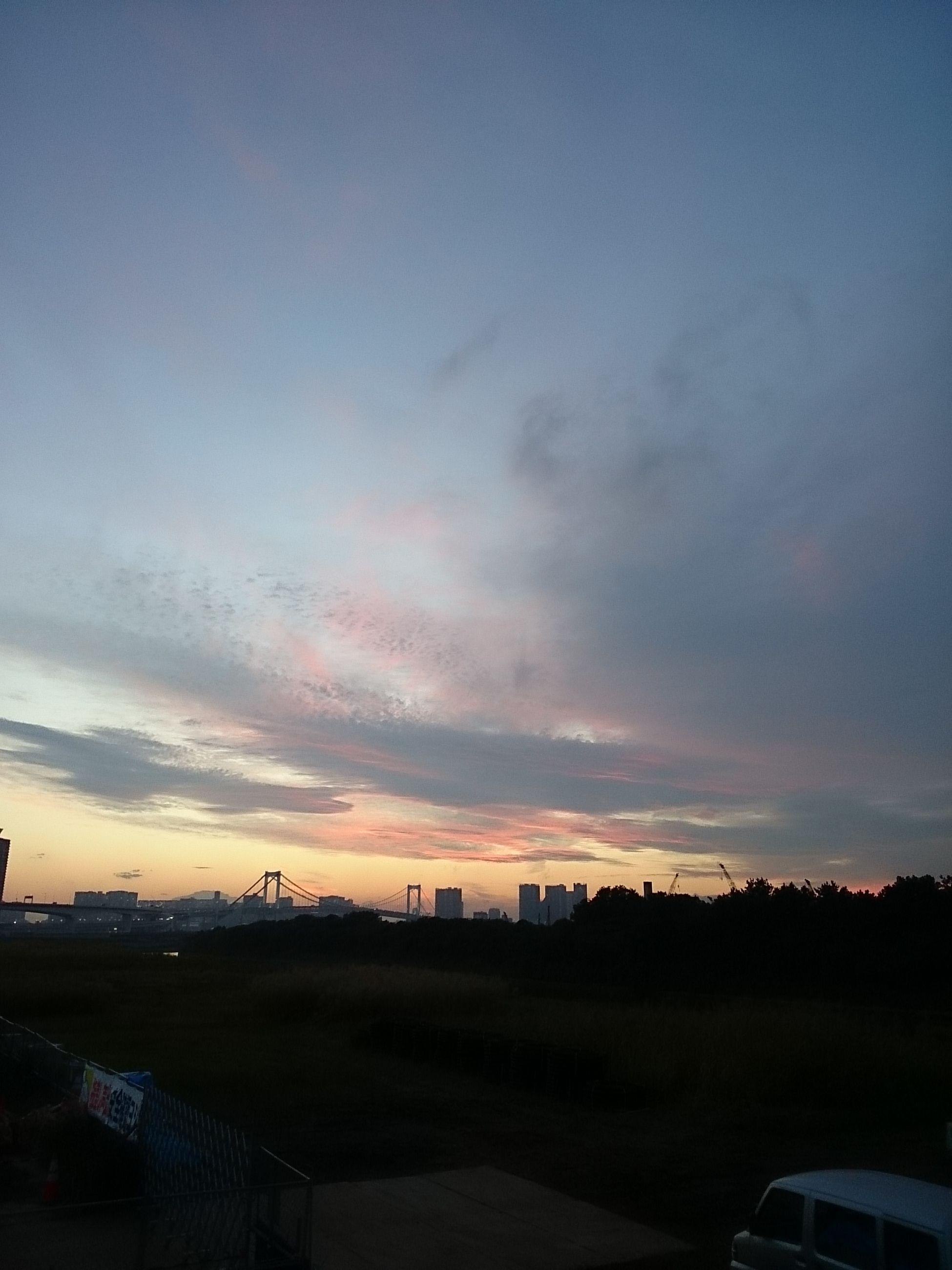 transportation, sky, car, road, land vehicle, mode of transport, sunset, street, mountain, cloud - sky, scenics, nature, sea, beauty in nature, outdoors, dusk, landscape, tranquil scene, travel, cloud