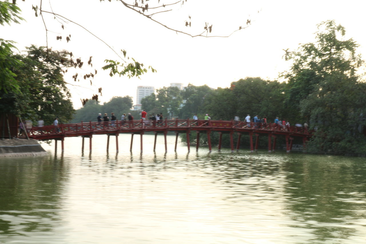 Huan kiem lake in Hanoi and The huc bridge Tree Water Outdoors Large Group Of People People Architecture Hanoi Vietnam  Hanoi, Vietnam Hanoilake Lake View Lake Red Bridge TheHuc Cityview Tourist Attractions Embrace Urban Life