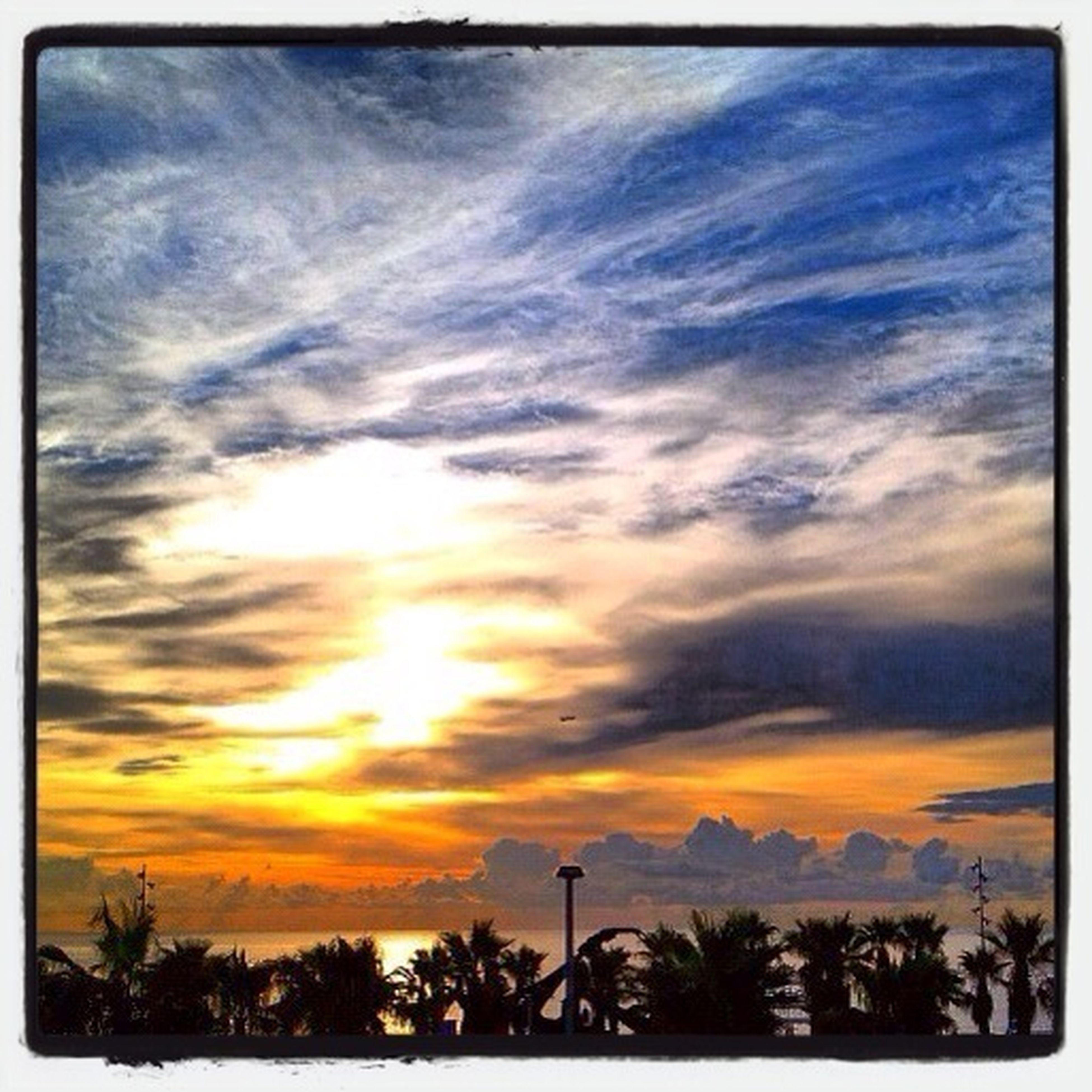 sunset, beauty in nature, sky, scenics, tranquil scene, tranquility, tree, silhouette, orange color, transfer print, cloud - sky, nature, idyllic, sun, landscape, cloud, auto post production filter, growth, sunlight, dramatic sky