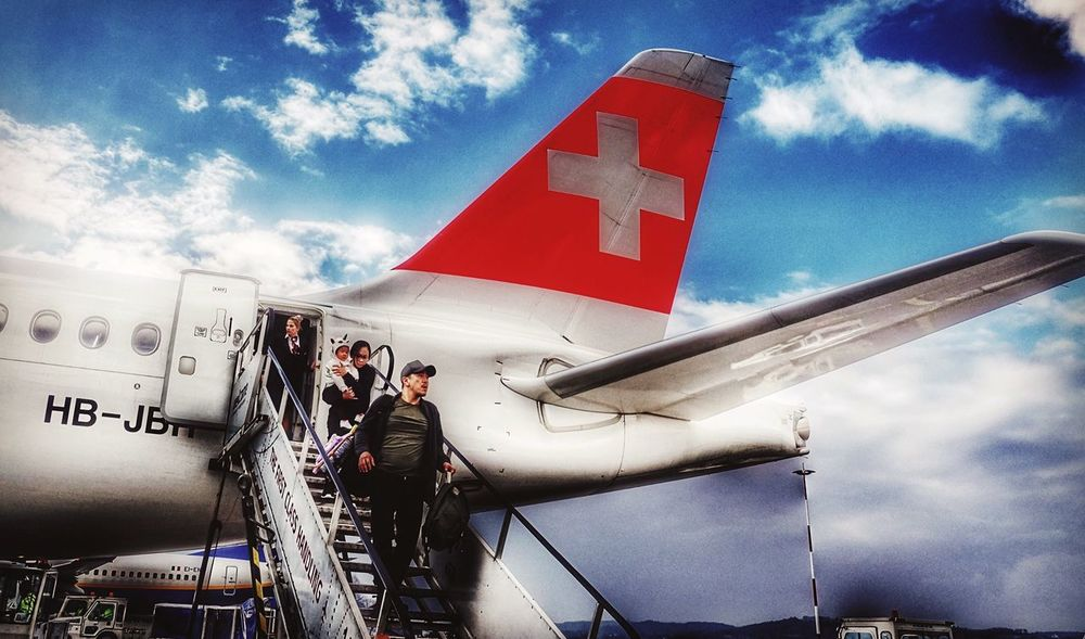 A Swiss arrival. Air Travel  Airplanes Airplane Landing Real People Hdr_Collection EyeEm Ready   Travel Swissair Traveling The World Arrival Low Angle View Touchdown Aircraft Wing Family Trip Family With One Child