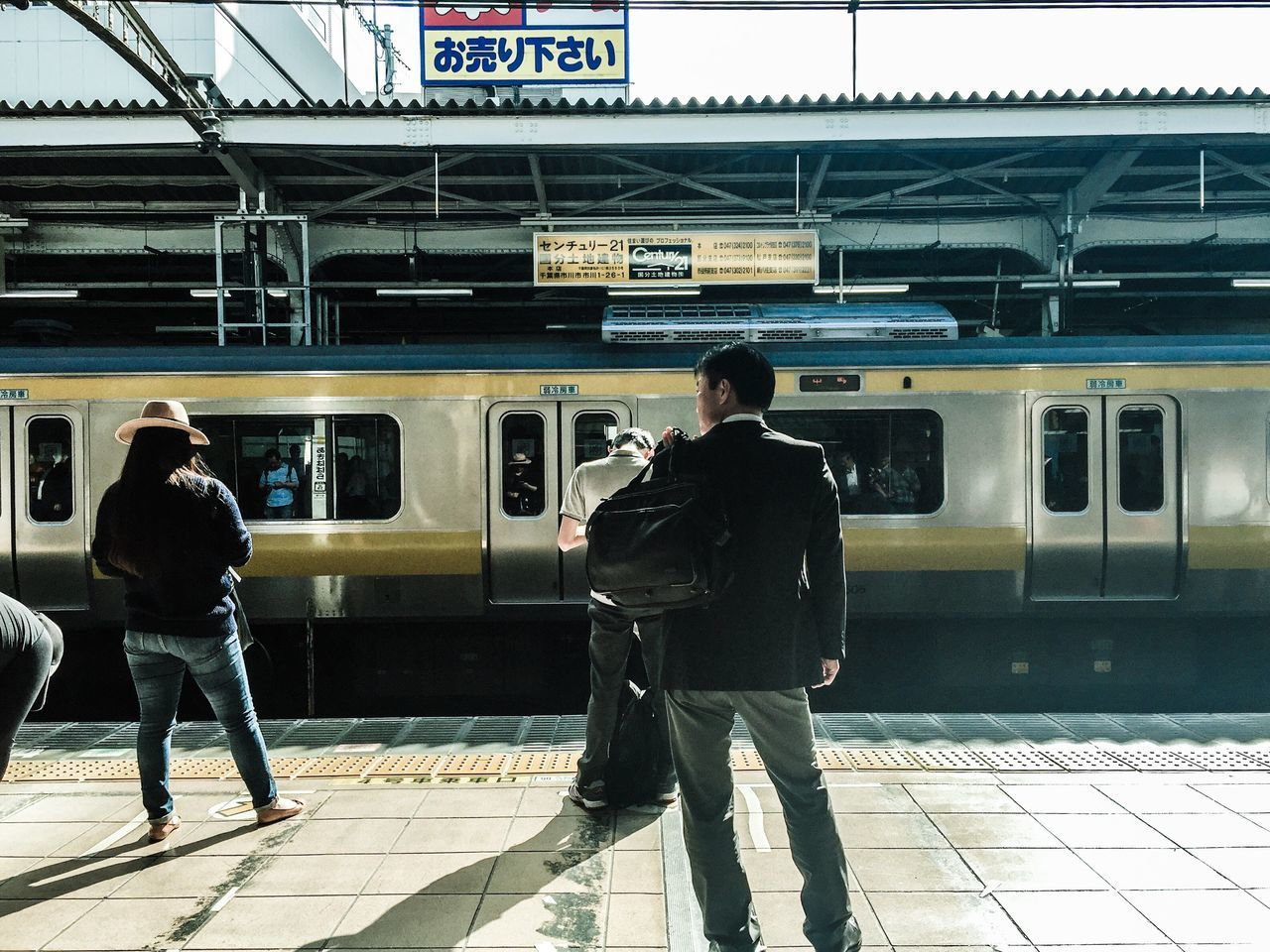 Transportation Full Length Public Transportation Train - Vehicle Travel Railroad Station Casual Clothing Journey Rear View Mode Of Transport Passenger Waiting Subway Platform Two People Standing Lifestyles Indoors  City Life Commuter Subway Train