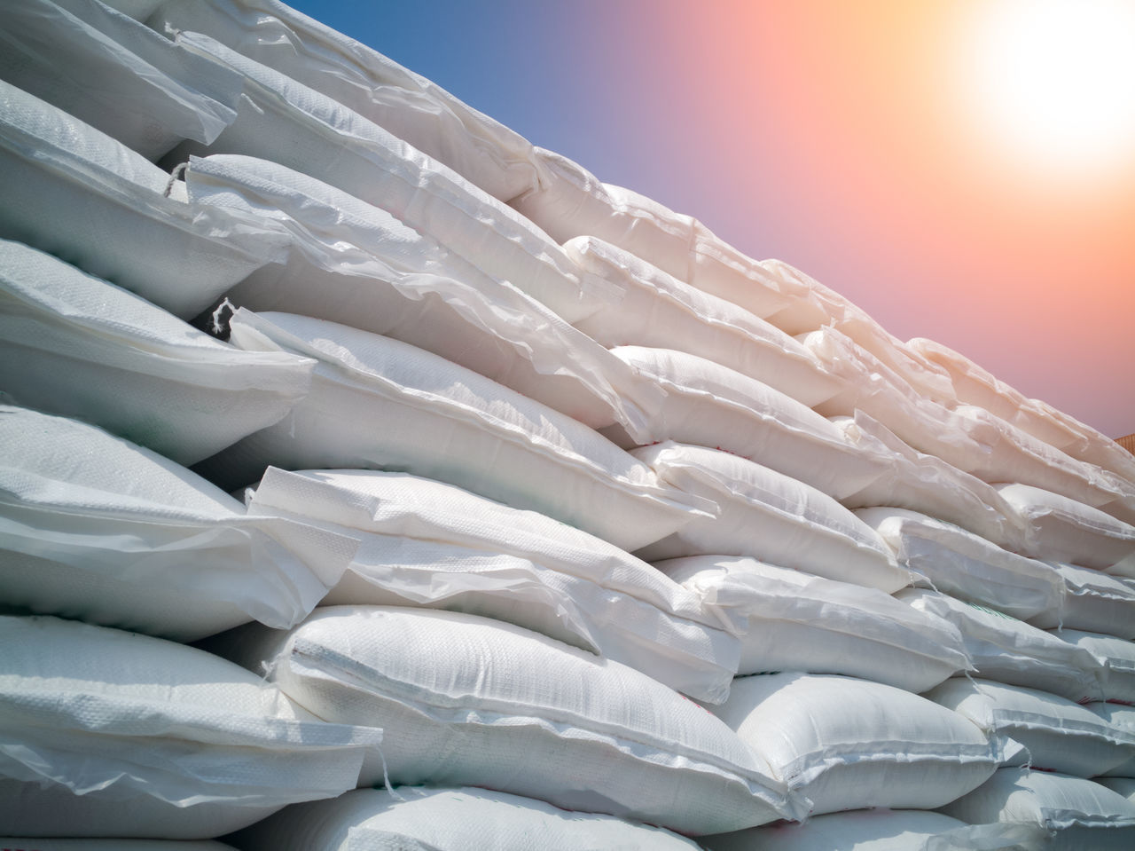 Stacking of sugar bags on truck Wrapping Wholesale White Wheat Warehouse Truck Transportation Trade Bulk Grain Rice Tapioca Row ship Import Export Bag Distribution packaging Seed Agronomy