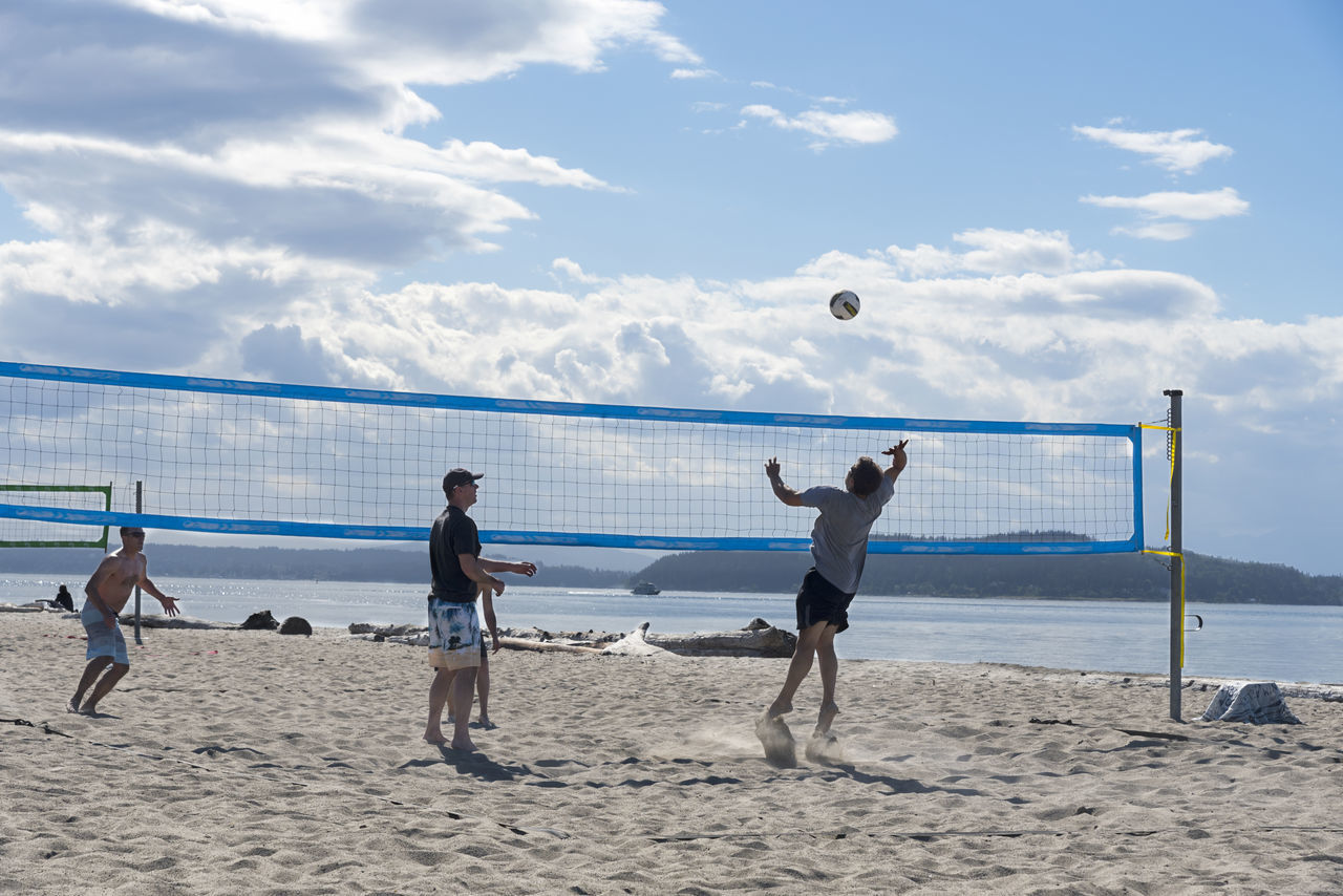 Friends at beach playing volleyball Ball Beach Beach Volleyball Cloud - Sky Day Full Length Horizon Over Water Leisure Activity Lifestyles Men Mid-air Nature Net - Sports Equipment Outdoors Playing Real People Sand Sea Sky Soccer Soccer Ball Sport Togetherness Volleyball - Sport Water