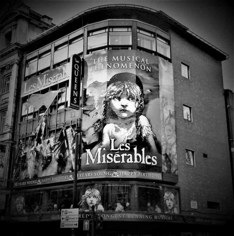 Here is a picture of Les Miserable in London Westend Queens Theatre in Black and White. Architecture Arts Culture And Entertainment Black And White Photography Building Exterior Built Structure Capital Letter City Communication Day Les Misérables London London Lifestyle London Trip London UK. Londonlife LONDON❤ Musicals Musicals. Musicals🎵 Outdoors Queens Theatre Theatres  United Kingdom Westend London Westend Performances