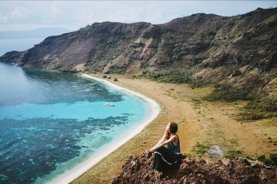 going east ⛵️ INDONESIA Nusa Tenggara Barat Sumbawa Komodo Island Trekking Traveling Girl Young Woman Hilltop Mountain Water Sea Tranquil Scene Vacations Scenics Tourism High Angle View Travel Idyllic Blue Turquoise Grassland Hills Southeastasia