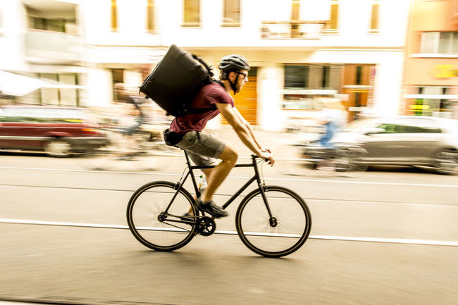 Food Delivery Biker Bicycle City City Life Cycling Deliveroo Food Delivery Foodora Motion One Person Panning Panning Shoot Panningshot Street