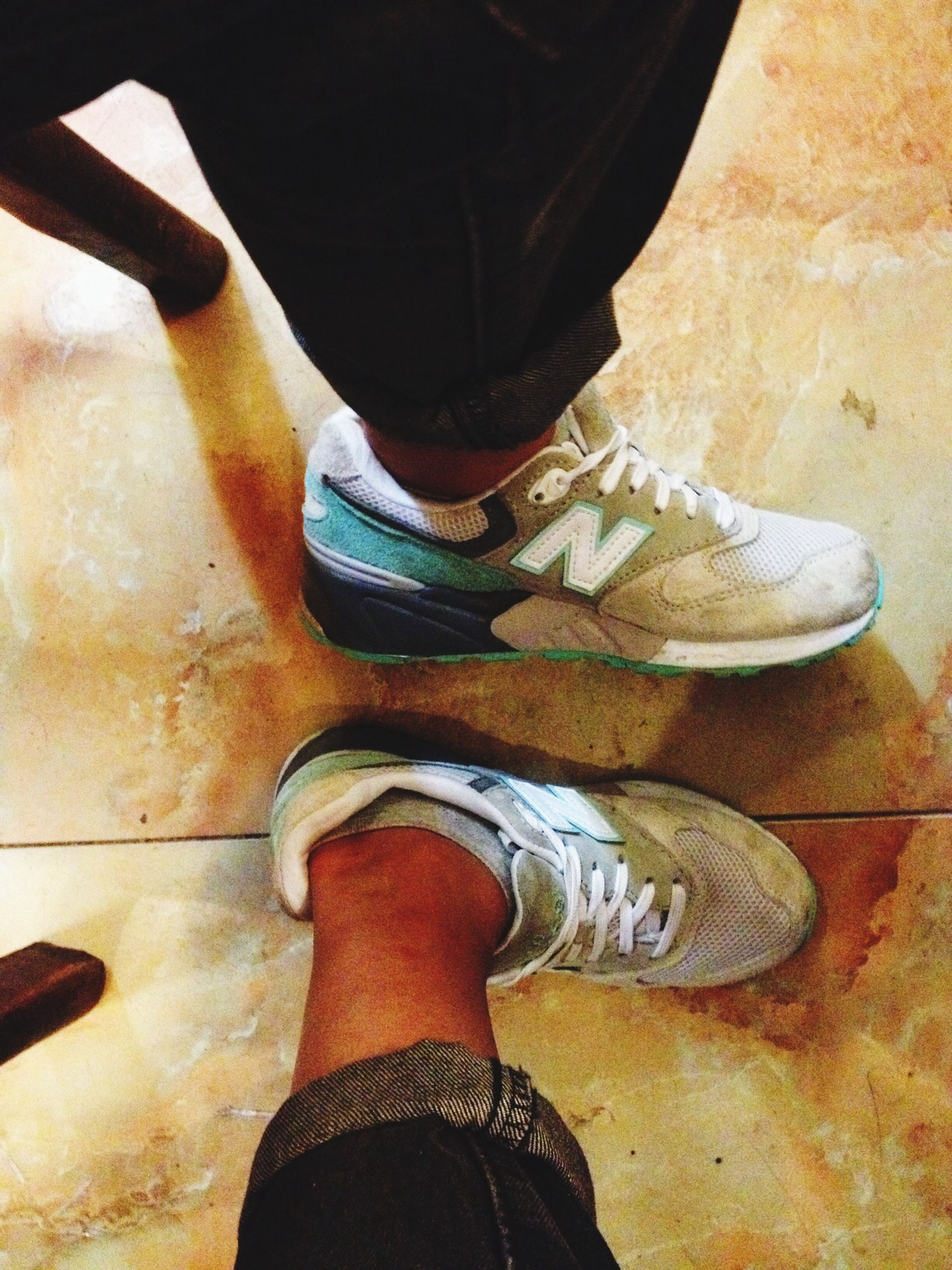 low section, person, shoe, human foot, footwear, personal perspective, standing, jeans, lifestyles, indoors, flooring, canvas shoe, high angle view, leisure activity, casual clothing, pair, sock